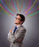 Young man thinking wiht colorful abstract lines overhead Royalty Free Stock Photos