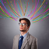 Young man thinking wiht colorful abstract lines overhead Stock Image