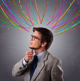 Young man thinking wiht colorful abstract lines overhead Stock Images
