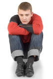 Young man in thoughtfulness. The young man sitting on a floor in thoughtfulness Royalty Free Stock Photo