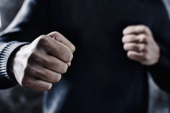 Young man with a threatening gesture Stock Photo