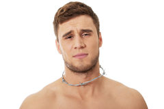 Young man with throat pain. Royalty Free Stock Photos