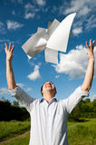 Young man throw documents on air Royalty Free Stock Photos