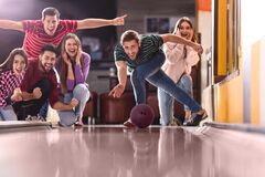 Free Young Man Throwing Ball And Spending Time With Friends In Bowling Stock Photo - 172903660