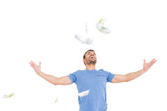 Young man throwing currency notes Royalty Free Stock Photos
