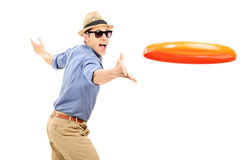 Young man throwing a frisbee disk Royalty Free Stock Photo