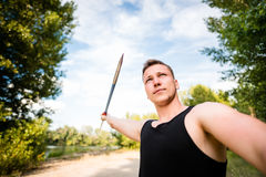 Young man throwing a javelin in nature Stock Photos