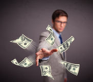 Young man throwing money Royalty Free Stock Photos