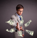 Young man throwing money Royalty Free Stock Photography
