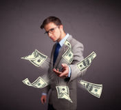 Young man throwing money Royalty Free Stock Photo