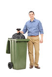 Young man throwing out the garbage Royalty Free Stock Image
