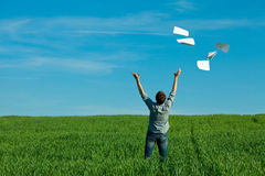 Young man throwing a paper Stock Photos