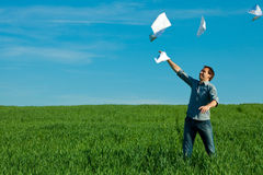 Young man throwing a paper Royalty Free Stock Image