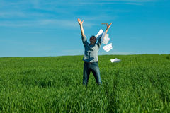 Young man throwing a paper Stock Image
