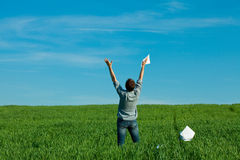 Young man throwing a paper Royalty Free Stock Images