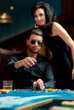 Young man throwing poker chips Stock Photography