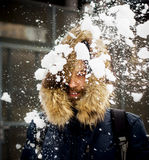 Young man throwing snow Royalty Free Stock Image