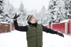 Young man throwing a snowball Royalty Free Stock Photos