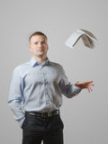 A young man throws the book Stock Photography
