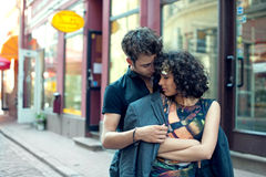 Young man throws his jacket over his girlfriend Royalty Free Stock Images