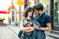 Young man throws his jacket over his girlfriend Stock Images