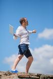 Young man throws a laptop Royalty Free Stock Photo