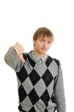 Young man thumb down Stock Image
