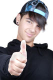 Young man with thumb up Stock Image