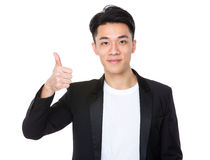 Young man with thumb up gesture Stock Photos