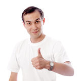 Young man thumb up isolated white Royalty Free Stock Images