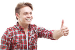 Young man thumbing up on white background Stock Images