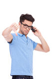 Young man thumbs down on the phone Stock Photography