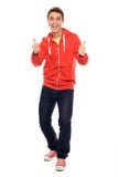 Young man with thumbs up Stock Images