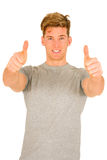 Young man with thumbs up. On a white background Stock Photo