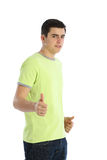 Young man thumbs up white background Royalty Free Stock Photography