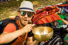 Young man with Tibetan bowl Stock Images