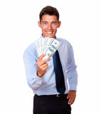 Young man in tie holding cash dollars Royalty Free Stock Photography