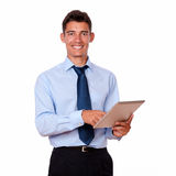 Young man in tie using his tablet pc Royalty Free Stock Photography