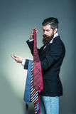 Young man with ties Royalty Free Stock Images