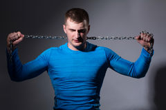 Young man with a tight chain Stock Photography