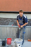 Young man tiling on balkony ceramic tiles Stock Photos