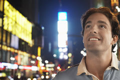 Young Man In Times Square New York At night. Closeup of a smiling young man in Times Square New York at night stock image