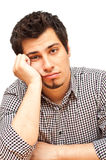 Young man with tired, indifferent expression Stock Photo