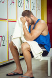 Young man tired in locker room sitting Stock Photos