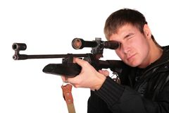Young man to aim from sniper gun Royalty Free Stock Photo