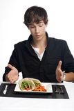 Young man about to eat delicious tacos. Young man about to eat plate of delicious tacos Royalty Free Stock Photography