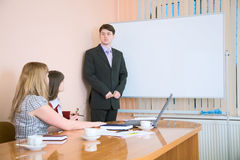 Young man to speak at a meeting Royalty Free Stock Photos
