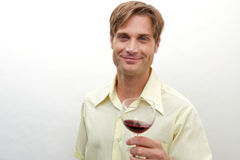 Young man toasting with a glass Stock Photography