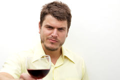 Young man toasting with a glass Royalty Free Stock Photography