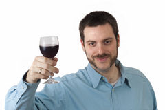 Young man toasting with glass of red wine Stock Photos